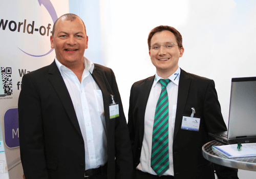Werner Dandl und Thomas Wagner auf einer Messe - präsentiert werden Fördermittel online